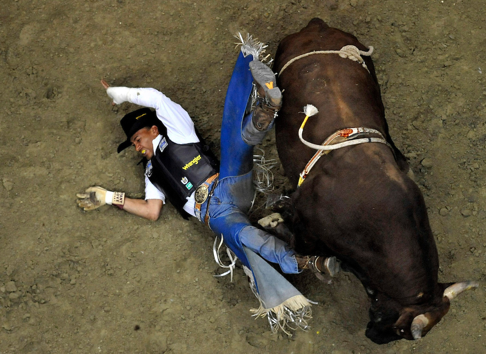 Valdiron De Olivera falls off SoulJa Boy during Saturday's Professional  Bull Riding Anaheim Invitational.