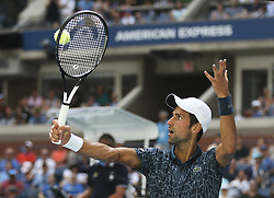 NEW YORK, Aug. 29, 2018  Novak Djokovic of Serbia hits a return during the men's singles first round match against Marton Fucsovics of Hungary at the 2018 US Open tennis championships in New York, the United States, Aug. 28, 2018. Djokovic won 3-1. (Credit Image: © Xinhua via ZUMA Wire)