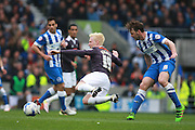 Derby County midfielder Will Hughes takes a tumble after being fouled by Brighton central midfielder Dale Stephens during the Sky Bet Championship match between Brighton and Hove Albion and Derby County at the American Express Community Stadium, Brighton and Hove, England on 2 May 2016. Photo by Bennett Dean.