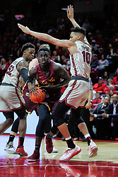 NORMAL, IL - February 02: Aher Uguak heads for the paint defended by Phil Fayne and Malik Yarbrough during a college basketball game between the ISU Redbirds and the University of Loyola Chicago Ramblers on February 02 2019 at Redbird Arena in Normal, IL. (Photo by Alan Look)