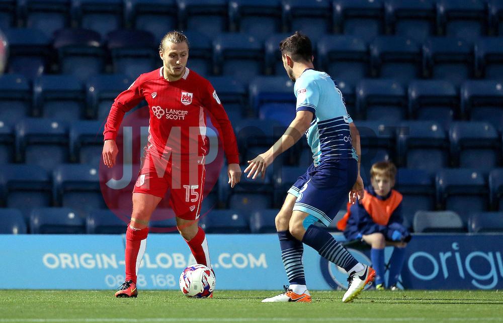 Luke Freeman of Bristol City runs at Joe Jacobson of Wycombe Wanderers - Mandatory by-line: Robbie Stephenson/JMP - 09/08/2016 - FOOTBALL - Adams Park - High Wycombe, England - Wycombe Wanderers v Bristol City - EFL League Cup