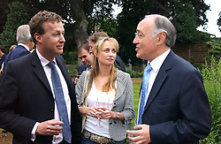 Left to right, ORLANDO FRASER, CLEMENTINE HAMBRO and MICHAEL HOWARD at the No Campaign's Summer Party - a celebration of the 'Non' and 'Nee' votes in the Europen referendum in France and The Netherlands held at The Peacock House, 8 Addison Road, London W14 on 5th July 2005.<br />