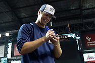 PHOENIX, AZ - JUNE 09:  Brett Phillips #33 of the Milwaukee Brewers signs an autograph for a fan prior to the MLB game against the Arizona Diamondbacks at Chase Field on June 9, 2017 in Phoenix, Arizona.  (Photo by Jennifer Stewart/Getty Images)