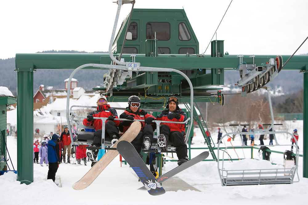 Riding the Quad chairlift at the Quechee Ski Hill in Quechee, Vermont. Model Release.