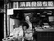 A woman sells halal food at a shop in Shanghai.