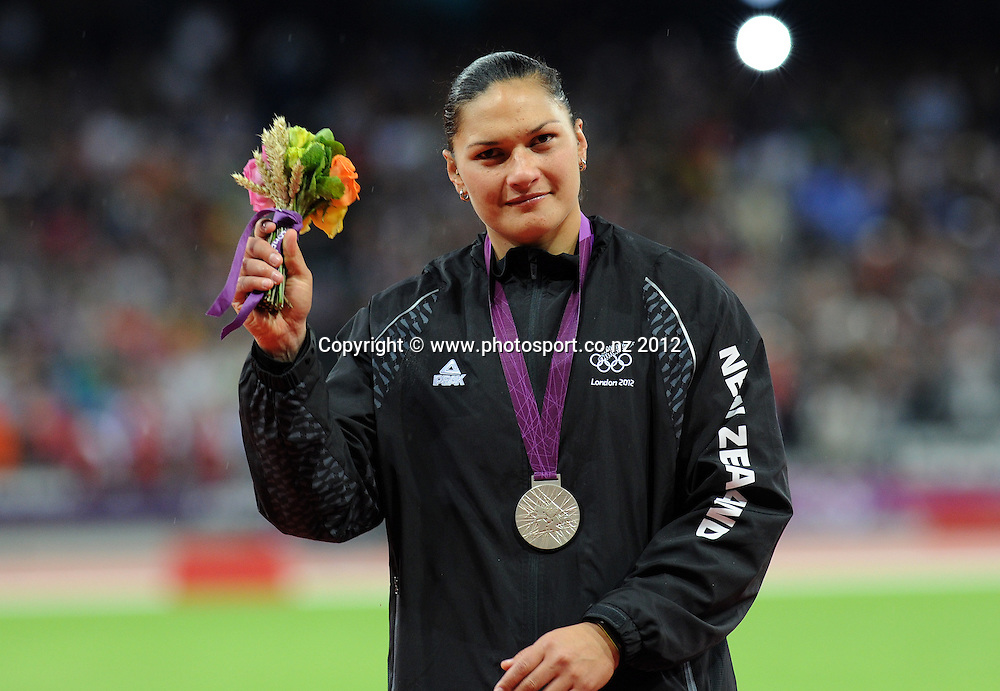 Valerie Adams of New Zealand shows off her silver medal in the Women's Shot Put Final at the medal ceremony. Track and Field. Olympic Stadium, London, United Kingdom. Monday 6 August 2012. Photo: Andrew Cornaga / photosport.co.nz
