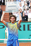 Roland Garros. Paris, France. May 25th 2008..Gustavo KUERTEN cries holding the trophy he received after his last tennis game as a professional player against Paul-Henri MATHIEU....