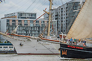The Wylde Swan passes the huge Dar Meodziezy - Royal Greenwich Tall Ships Festival with a fleet of square rigged ships moored on the Thames at Greenwich and Woolwich. The fleet includes two of the biggest Class A Tall Ships - the Dar Mlodziezy and Santa Maria Manuela - which are moored on Tall Ships Island in the river off Greenwich. Tall Ships Festival Day on Saturday 29 August featured free family entertainment and the chance to enjoy a taste of life on the high seas.