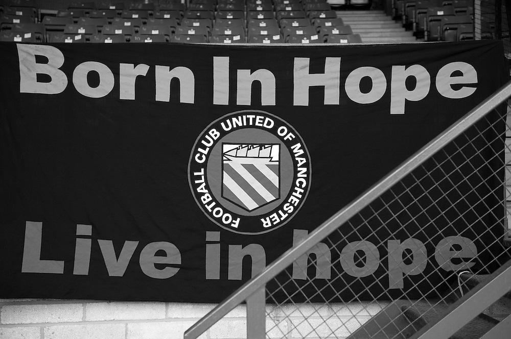 FC United of Manchester play a local team Chorley at Bury football club's ground in Lancashire, Britain. Photo shows a banner at the match.