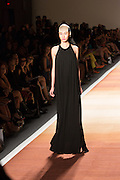 A floor-length black knit halter-top dress.