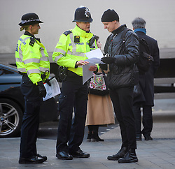 © Licensed to London News Pictures. 17/12/2018. London, UK.  Police officers hand out notices to the public during trials by the Metropolitan Police of facial recognition technology in central London. The surveillance software is being used overtly with a uniformed presence. Privacy campaigners have expressed concerns about the use of the technology. Photo credit: Ben Cawthra/LNP