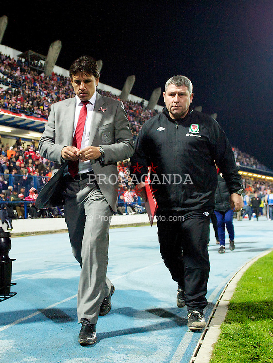 OSIJEK, CROATIA - Tuesday, October 16, 2012: Wales' manager Chris Coleman and coach Osian Roberts walk to the dressing room at half time during the Brazil 2014 FIFA World Cup Qualifying Group A match against Croatia at the Stadion Gradski Vrt. (Pic by David Rawcliffe/Propaganda)