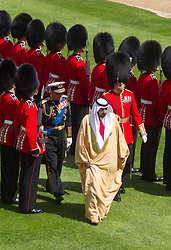 WINDSOR-ENGLAND-30-APR-2013- The President of the United Arab Emirates, His Highness Sheikh Khalifa bin Zayed Al Nahyan, arrives in Windsor for a State Visit to the United Kingdom as the guest of Her Majesty The Queen. His Higness arrived at Windsor Castle by  carriage , inspected the Guard of Honour and then after a brief meeting with the Queen attended a Stat Lunch in the Waterloo Chamber of Windsor Castle..Photo by Ian Jones