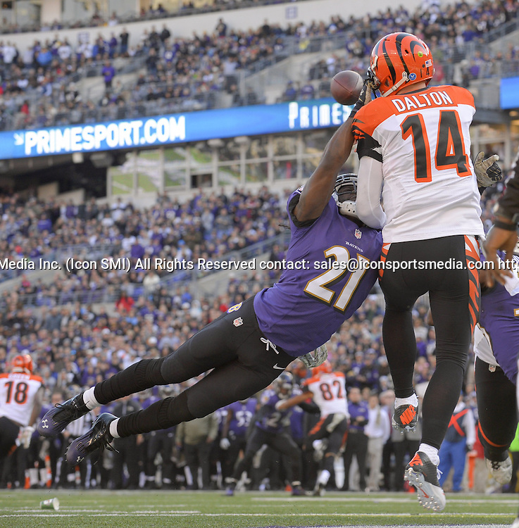 Nov. 10, 2013 - Baltimore, MD, USA - Cincinnati Bengals quarterback Andy Dalton manages to get off a pass from the end zone as he's hit by blitzing Baltimore Ravens cornerback Lardarius Webb during the second half of their game, won by the Ravens in overtime, 20-17, in Baltimore on Sunday, November 10, 2013