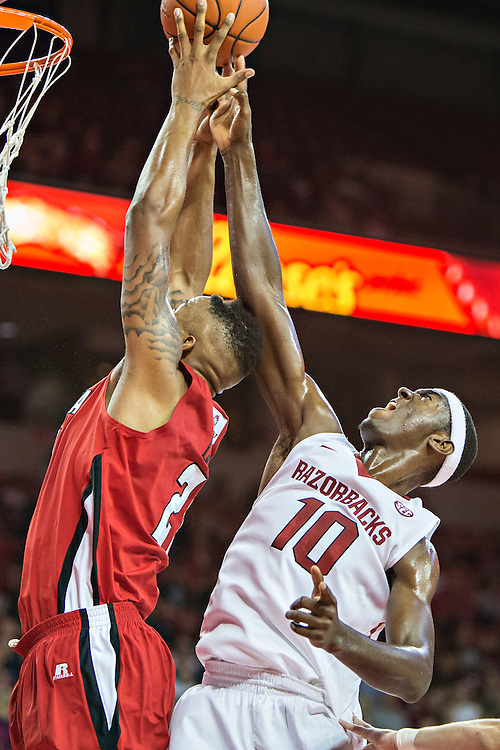 FAYETTEVILLE, AR - NOVEMBER 15:  Bobby Portis #10 of the Arkansas Razorbacks goes up for a rebound with Shawn Long #21 of the Louisiana Ragin' Cajuns at Bud Walton Arena on November 15, 2013 in Fayetteville, Arkansas.  The Razorbacks defeated the Ragin' Cajuns 76-63.  (Photo by Wesley Hitt/Getty Images) *** Local Caption *** Bobby Portis; Shawn Long