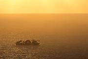 Ship in sunset. A Subsea 7 vessel in sunset, passing Runde, Norway | Skip i solnedgang. En Subsea 7 båt i solnedgang på vei forbi Runde.