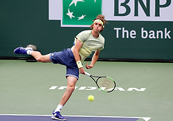 March 10, 2018 - Indian Wells, CA, U.S. - INDIAN WELLS, CA - MARCH 10: Stefanos Tsitsipas ( GRE ) hits a serve during the second round of the BNP Paribas Open on March 10, 2018, at the Indian Wells Tennis Gardens in Indian Wells, CA. (Photo by Adam  Davis/Icon Sportswire) (Credit Image: © Adam Davis/Icon SMI via ZUMA Press)