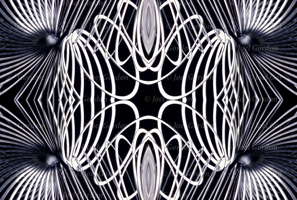 Computer generated abstract mirrored images of a Slinky creating endless patterns of shaped and forms.