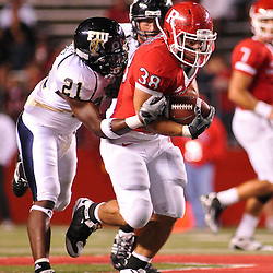 Sep 19, 2009; Piscataway, NJ, USA; Rutgers running back Joe Martinek (38) drags Florida International safety Chuck Grace (21) during the second half of Rutgers' 23-15 victory over Florida International at Rutgers Stadium.