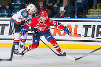 KELOWNA, CANADA - JANUARY 4: Jake Kryski #14 of the Kelowna Rockets back checks Hudson Elynuik #26 of the Spokane Chiefs on January 4, 2017 at Prospera Place in Kelowna, British Columbia, Canada.  (Photo by Marissa Baecker/Shoot the Breeze)  *** Local Caption ***