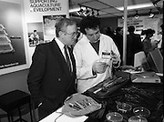 The 1989 Boat Show.   (R89)..1989..10.03.1989..03.10.1989..10th March 1989..Pat the Cope GallagherTD, Minister for the Marine attended the opening of the 1989 Boat Show held at the Point Depot, Dublin. The opening coincided with the minister's birthday...A staff member of Carrolls Aquaculture is pictured examining a fish with the Minister.