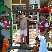 Photograph of school children acting out the crucifixion sparks outrage as picture goes viral<br /> <br /> An image of children play-acting the crucifixion of Jesus Christ at an unidentified school in Brazil for Holy Week complete with fake wounds and a crown of thorns has spread across the Internet.<br /> Wearing a loin cloth and a fake painted beard, the boy who acts as Jesus holds his two arms above his neck, to signify the last agonizing hours of Christ on the cross.<br /> Flecked across his body are red marks from his flogging at the hands of the Romans - played by two boys with mock-feathered galea helmets, who will presumably offer him fake vinegar and pretend to stab his side to ensure he has died at the culmination of the play.<br /> <br /> In the front of the picture are two young girls playing the role of Jesus' mother, Mary and follower Mary Magdalene, who according to the Bible tearfully witnessed his death on Calvary.<br /> The picture has been shared and liked some 230,000 times on Facebook and the reactions to the picture appear to vary from country to country.<br /> <br /> Commenters writing in English and Portuguese appear to dislike the imagery on show in the photograph , with many seemingly mocking children acting out a religious scene.<br /> One has posted the message, 'There seems to be no sign of intelligent life anywhere' in response to the image.<br /> <br /> Others have made the point that the crucifixion and death of Jesus Christ and its message may be difficult for children to understand.<br /> Some have claimed that the exposure of children to the story is akin to manipulation - despite Brazil's status as the world's most populus Catholic country.<br /> However, most messages on the Facebook page are in praise of the image - with the majority standing up for the right of the school and children to depict the scene.<br /> One woman, Carlos Ferreira calls the criticism 'ridiculous', emphasizing the importance of the young learning 'the meaning of Easter and the story of Christ.'<br /> ©Exclusivepix