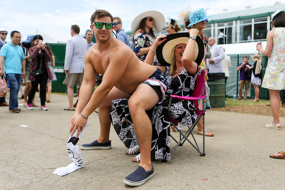 LOUISVILLE, KY - MAY 7:  Spectator Rob Bielecki offers 1$ lap dances in the infield prior to the 142nd running of the Kentucky Derby at Churchill Downs on May 7, 2016 in Louisville, Kentucky. (Photo by Michael Reaves/Getty Images)