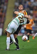 James Hanson of Bradford City and Ben Nugent of Yeovil Town during the Sky Bet League 1 match at the Coral Windows Stadium, Bradford<br /> Picture by Richard Land/Focus Images Ltd +44 7713 507003<br /> 06/09/2014