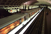 USA, Washington, DC. A train passes through a Metro station.