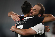 Juventus's Argentinian striker Gonzalo Higuain celebrates with Portuguese striker Cristiano Ronaldo after scoring to give the side a 3-0 lead during the Serie A match at Allianz Stadium, Turin. Picture date: 26th June 2020. Picture credit should read: Jonathan Moscrop/Sportimage