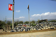 Discarded screens lie by the side of the road in an area where much of the world's electronic-waste _ from cell phone chargers to mainframe computers _ ends up in Nanyang, Guiyu and other small towns like it in eastern China, Thursday March 16, 2006. Workers, many of them poorly paid migrants strip, smash and melt down circuit boards, mainly to extract the copper and other precious metals inside.The business has created massive pollution from leaded glass and other toxic materials. Such pollution could be mitigated by moves to recycle and properly dispose of so-called electronic waste that are gaining ground in the West.