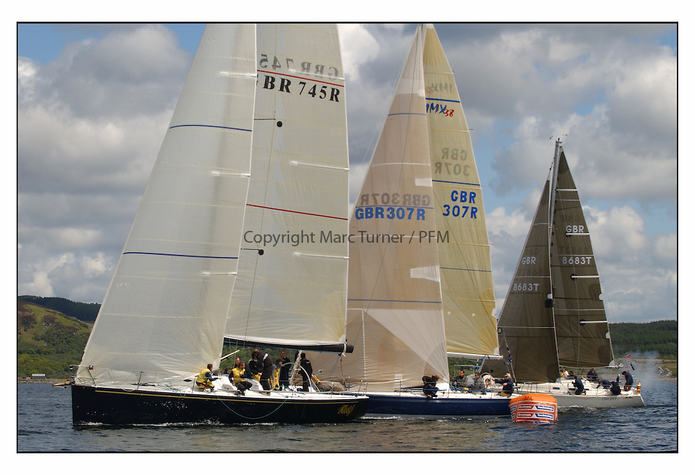 The final days racing at the Bell Lawrie Yachting Series in Tarbert Loch Fyne ..The overall winners were decided in most classes on the last days racing...Class one's Farr 45  GBR745R Wolf with IMX38 GBR307R Hummingbird and ROBO GBR 8663 of Class 3 - ( ROBO's Mainsheet man was shot be the cannon shot from the finish gun leaving a nasty welt ! ).