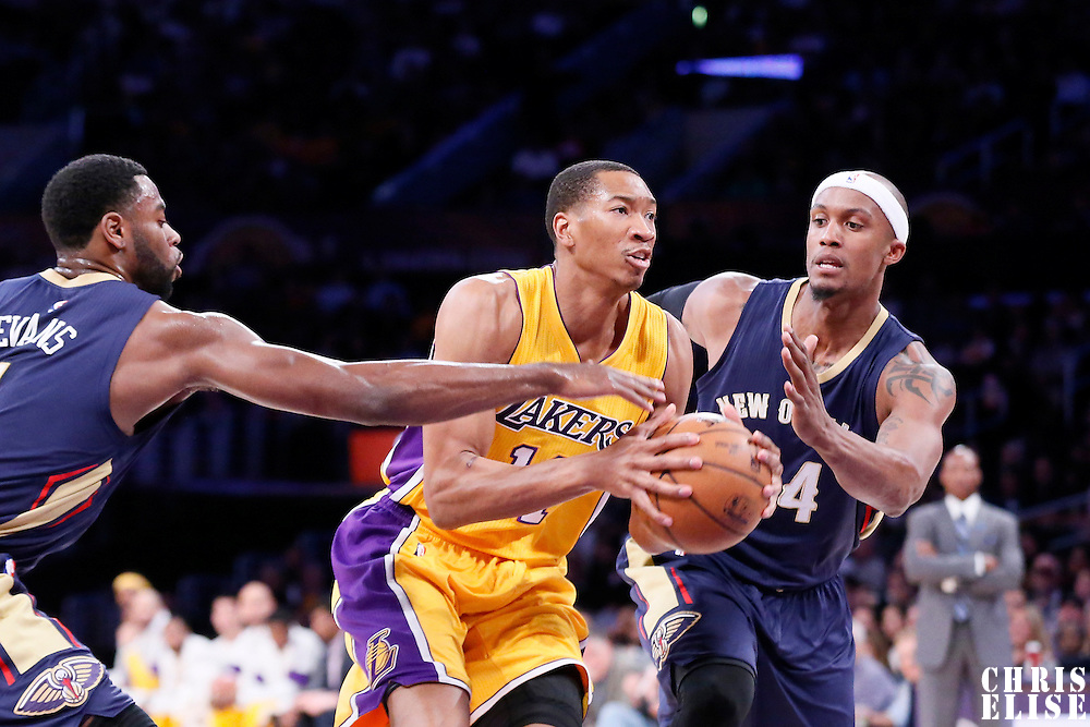 01 April 2015: Los Angeles Lakers forward Wesley Johnson (11) drives past New Orleans Pelicans forward Dante Cunningham (44) and New Orleans Pelicans guard Tyreke Evans (1) during the New Orleans Pelicans 113-92 victory over the Los Angeles Lakers , at the Staples Center, Los Angeles, California, USA.