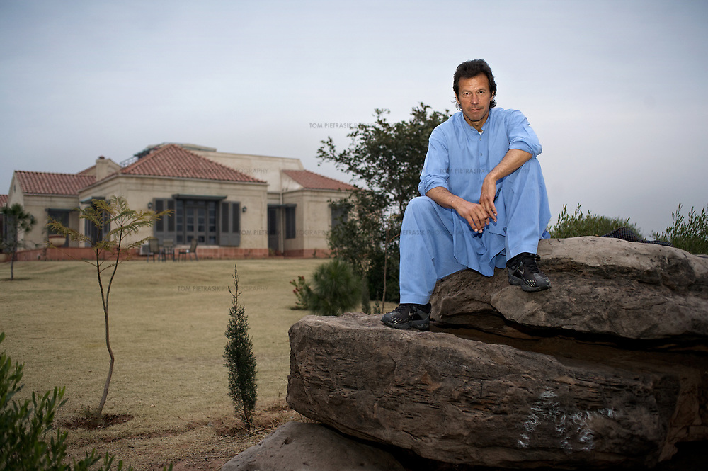 Imran Khan in the grounds of his house which sits on a hill overlooking Islamabad.<br /><br />Cricketer Imran Khan made his Test debut against England in 1971. He became captain of the Pakistan team in 1982 and lead them to World Cup victory in 1992 after which he retired.<br /><br />Imran Khan established the Tehrik-e-insaaf (or Moverment for Justice) in 1996. Through Tehrik-e-insaaf, Khan has demanded that the Pakistan government make institutional reforms to address corruption and end the present dictatorship. Khan would like a more equitable distribution of resources in Pakistan, the granting key civil liberties and an increas in public service spending. He is particularly scathing of the relationship between President Musharraf and US President Bush.<br /><br />Imran Khan became a Member of the Pakistani Parliament for Mianwali, Panjab, in the October 2002 elections.<br /><br />Photo: Tom Pietrasik<br />Islamabad Pakistan<br />27th January 2006