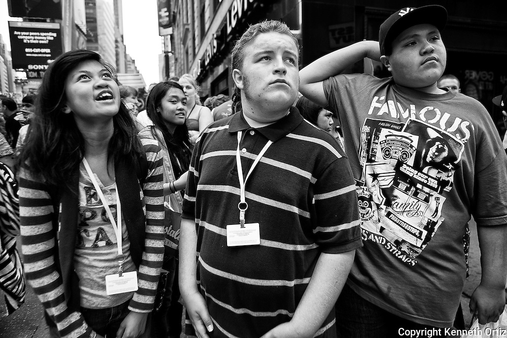 A shot of kids at a corner in Time Square New York City.