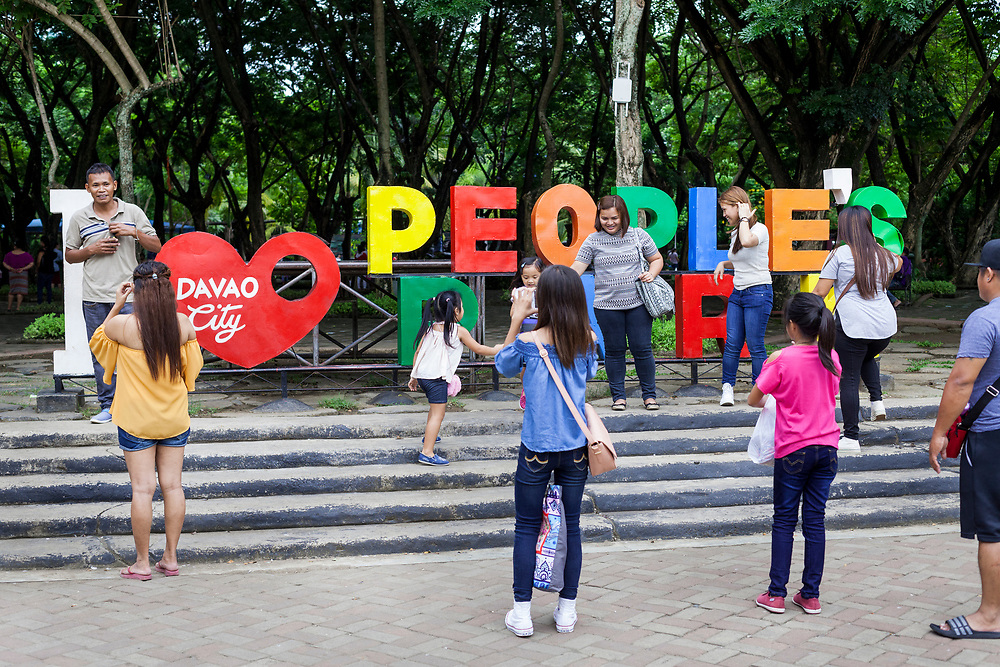 Davao City, Mindanao, Philippines - JUNE 18:  Visitors pose for a photos at the People's Park on a Sunday afternoon.