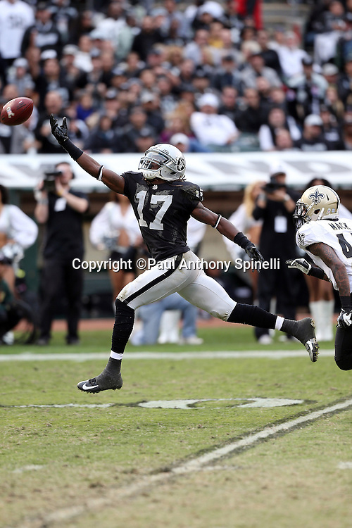 Oakland Raiders wide receiver Denarius Moore (17) leaps and reaches for an incomplete pass while covered by New Orleans Saints defensive back Elbert Mack (44) during the NFL week 11 football game against the New Orleans Saints on Sunday, Nov. 18, 2012 in Oakland, Calif. The Saints won the game 38-17. ©Paul Anthony Spinelli