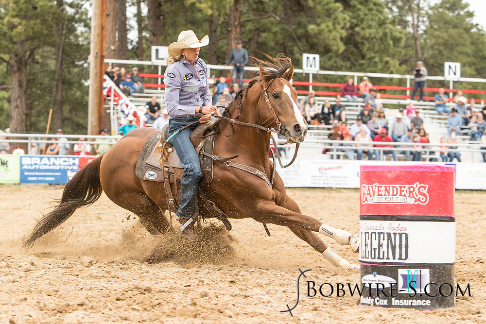 Shali Lord makes her barrel racing run during the third performance of the Elizabeth Stampede on Sunday, June 3, 2018.