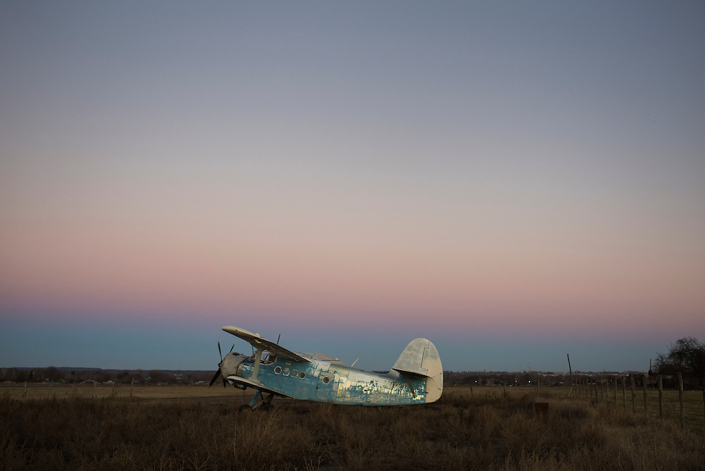 An Antonov An-2 aircraft sits at an airfield on the outskirts of town at sunset on December 8, 2015 in Hlukhiv, Ukraine.