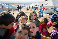 Internally displaced Syrians, including children, at a refugee camp near the Turkish border in Atmeh, Syria