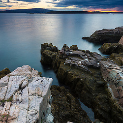 Sunset from the Schoodic Peninsula in Maine's Acadia National Park.