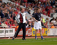 Photo. Glyn Thomas,  Digitalsport<br />Middlesbrough v Everton. Barclaycard Premiership.<br />Riverside Stadium, Middlesbrough. 21/09/2003.<br />Everton manager David Moyes (R) is disappointed to have lost, while his opposite number Steve McLaren is animated as he tries to prevent Everton from scoring an equaliser.