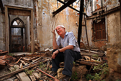 British journalist Robert Fisk sits inside a building destroyed in Beirut's 15 year civil war in Beirut, Lebanon on March 25, 2008.The building was along the city's infamous Green Line. His new book is The Age of the Warrior: Selected Essays by Robert Fisk, a collection of his Saturday columns for the British newspaper The Independent.
