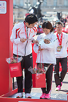Women's T11-13 IPC Marathon Cup race runner-up Misato Michishita of Japan on the podium at the Virgin Money London Marathon 2014 at the finish line on Sunday 13 April 2014<br />