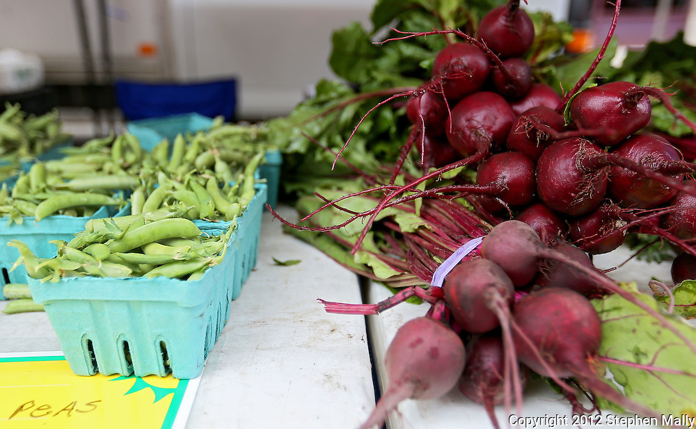 Fresh produce for sale at the Downtown Farmers' Market in Cedar Rapids on Saturday morning, June 2, 2012. There were 244 vendors who participated in the first market of the year. (Stephen Mally/Freelance)