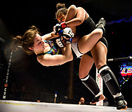October 11, 2013 - Melana Smith, right, throws down Farren Romero during the GetDown IX MMA Fight at The Yost Theater.<br /> <br /> <br /> /// ADDITIONAL INFORMATION: 10/11/13 - 1017.SPN.MMAFIGHT - FOSTER SNELL, - ORANGE COUNTY REGISTER San Clemente fighters Ivan &quot;Nino Demoledor&quot; Lopez vs Joshua Jones. GetDown IX MMA Fight at The Yost Theater. Ivan Lopez won the 158lb championship.