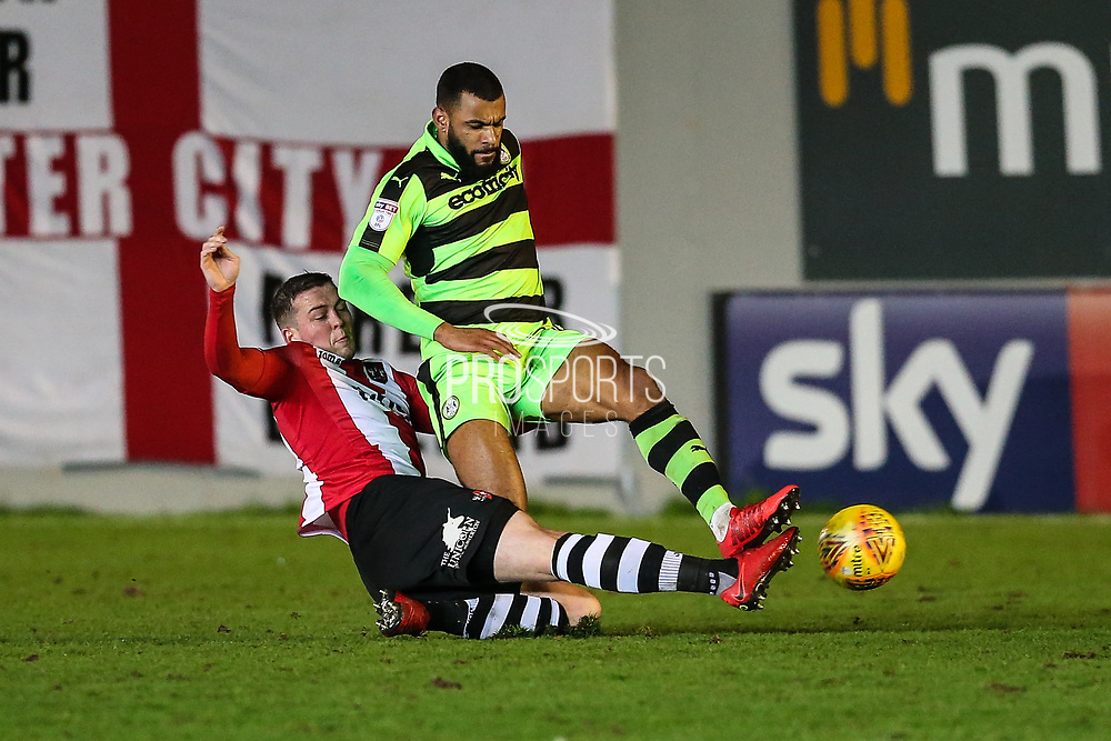Forest Green Rovers Dan Wishart(17) is tackled by Exeter City's Pierce Sweeney(2) during the EFL Sky Bet League 2 match between Exeter City and Forest Green Rovers at St James' Park, Exeter, England on 31 January 2018. Photo by Shane Healey.