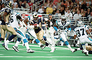 Running back Trung Canidate (24) of the St. Louis Rams runs through the Carolina Panthers defense during a 48 to 14 win by the Rams on 11/11/2001..©Wesley Hitt/NFL Photos