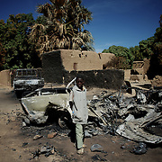 January 21, 2013 - Diabaly, Mali: A local child stands by destroyed islamic militants' armoured vehicles in central Diabaly, a day after Mali government troops regain control of the city. Diabaly was under islamist militants control since the 14th of January.<br />