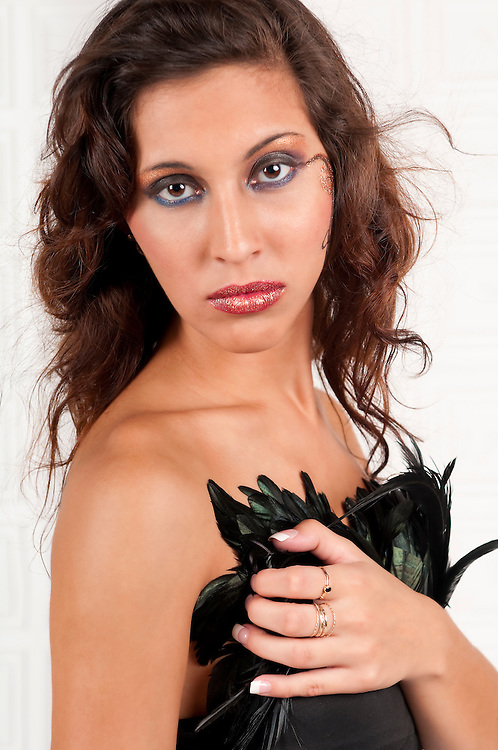 Young hispanic woman portrair with make up looking at camera.